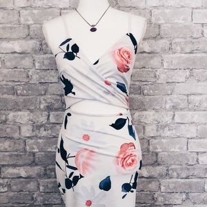 Dresses & Skirts - Floral white cut out dress